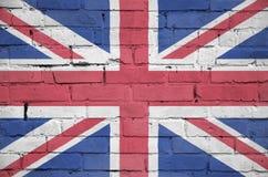 Großbritannien-Flagge wird auf eine alte Backsteinmauer gemalt lizenzfreies stockbild
