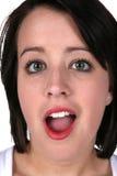 Große Augen und ein geöffneter Mund Stockbilder