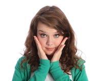 Große blaue Augen des überraschten Brunettejugendlichmädchens Stockbild