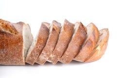 Große Brotschnittstücke auf weißem Hintergrund Stockbild