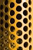 Große gelbe gebogene Platte des Lochmusters Stockbild
