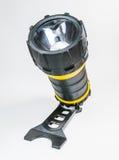 Große gelbe Taschenlampe Hand mit dem justierbaren Winkel lokalisiert auf weißem Hintergrund Lizenzfreies Stockbild