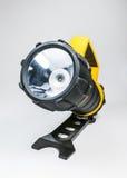 Große gelbe Taschenlampe Hand mit dem justierbaren Winkel lokalisiert auf weißem Hintergrund Lizenzfreie Stockfotografie