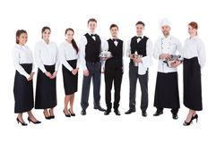 Große Gruppe Kellner und Kellnerinnen stockfoto