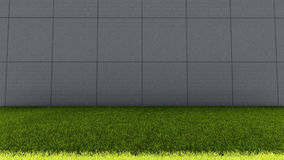 Große konkrete Ziegelstein-Wand-und grünes Gras-Boden lizenzfreies stockfoto