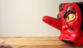 Große Nase und rotes Gesicht von Noh-Maske Stockfotografie