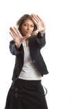 Große schauende Geschäftsfrau Stockfoto