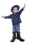 Große Stiefel für kleinen Jungen lizenzfreie stockbilder