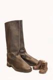 Große Stiefel und kleine Schuhe Lizenzfreie Stockfotografie