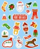 Große Weihnachtsaufkleber eingestellt auf blauen Hintergrund Lizenzfreie Stockfotos