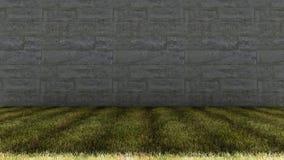 Große Zement-Ziegelstein-Wand und Gras-Boden lizenzfreies stockfoto