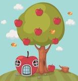 Großer Baumapfel und Apfelhaus Stockbild