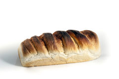 Großer Brotlaib lokalisiert auf Weiß Lizenzfreies Stockbild