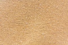 Großer goldener Sand des Meeres, die Meeresoberflächeküste, Beschaffenheit, Hintergrund lizenzfreie stockbilder