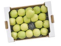 Großer Großhandelskasten goldene Delious-Gelbgrünäpfel, isola Stockfotografie