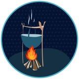 Großer Kessel über einem Feuer in einem Kreis mit Tupfen Lizenzfreies Stockfoto