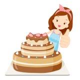 Großer Kuchen mit Mädchen-Bums oben Lizenzfreie Stockfotos