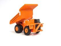 Großer orange Kipplaster des Spielzeugs Stockfotografie
