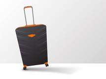 Großer orange und schwarzer Koffer auf Rädern mit Teleskopstiel Stockbilder