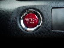 Großer roter Fintech-Knopf auf dem schwarzen Hintergrund Lizenzfreies Stockbild