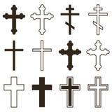 Großer Satz christliche Orthodoxiekreuze in den verschiedenen Arten und Formen lokalisiert auf weißem Hintergrund Stockbilder