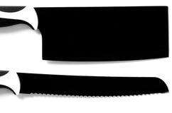 Großes Messer s des schwarzen Chefs 'für das Fleisch und Brot lokalisiert auf Weiß Lizenzfreies Stockbild