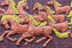 Großes Pferd des Mörsers auf Wand lizenzfreie stockfotografie