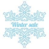 Großes Schneeflockensymbol mit Saisonwinterschlussverkaufmitteilung Stockfotos