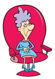 Großmutter, die in einem großen Stuhl sitzt Stockfotos