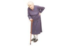Großmutter, die einen Stock anhält Stockfotografie