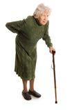 Großmutter, die einen Stock auf weißem Hintergrund anhält Stockbild