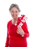 Großmutter mit einem Geschenk für Muttertag - ältere Frau lokalisiert Stockbild