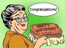 Großmutter wünscht einen alles- Gute zum Geburtstagkuchen Stockbild