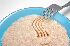 Groats  in  plate on white Royalty Free Stock Photo