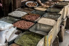 Groats for sale on Nepalese street market. Groats grains in rectangular metal canisters for sale on Nepalese street market, Nepal Stock Photo