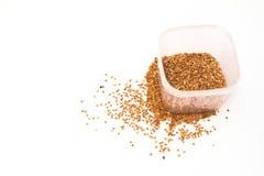 Groats on white background. Buckwheat is sprinkled / premium buckwheat groats on white background Stock Image