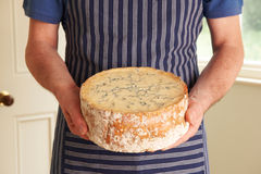 Grocer Holding Shropshire Blue Cheese Stock Photos