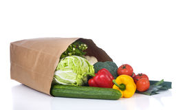 Groceries. A grocery bag full of healthy vegetables and fuits Royalty Free Stock Photography