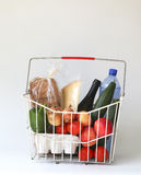 Groceries in basket Stock Images