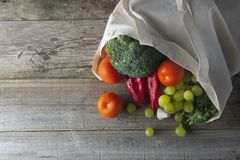Groceries in eco bag. Eco natural bag with fruits and vegetables. Zero waste food shopping. Plastic free items. reuse, reduce,. Recycle. Wooden rustic board stock image
