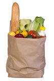 Groceries in paper bag isolated on white Royalty Free Stock Image