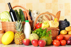 Groceries in wicker basket Royalty Free Stock Image