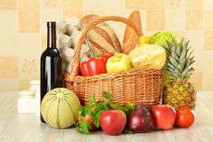 Groceries in wicker basket Royalty Free Stock Photos