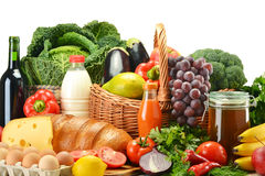 Groceries in wicker basket including vegetables and fruits Royalty Free Stock Photography