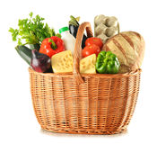Groceries in wicker basket isolated on white Royalty Free Stock Photos