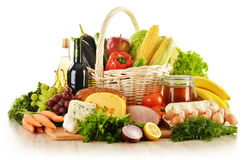Groceries in wicker basket on kitchen table Royalty Free Stock Photos