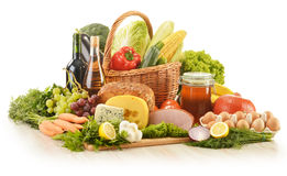 Groceries in wicker basket on kitchen table Stock Photo
