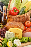 Groceries in wicker basket on kitchen table Royalty Free Stock Image