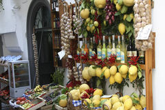 Grocery in Amalfi. Fruits at display at a grocery in the resort of Amalfi, Italy. Amalfi is a town and comune in the province of Salerno, in the region of Stock Photo