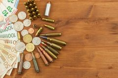 Grocery ammunition, weapons and ammunition sales. Valid euro banknotes and coins. Different types of ammunition. Preparing for war stock photography